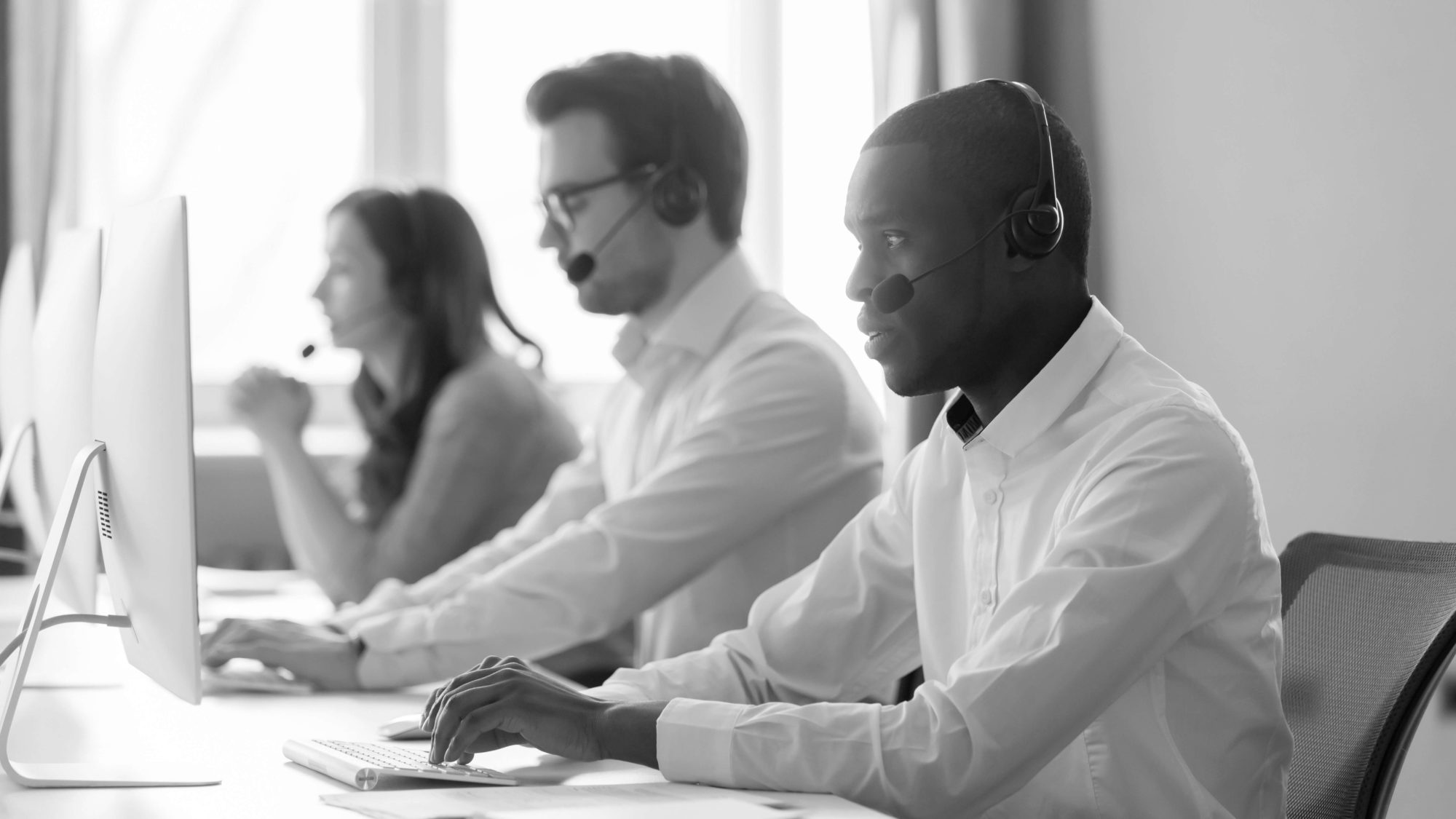 Three people working at call center